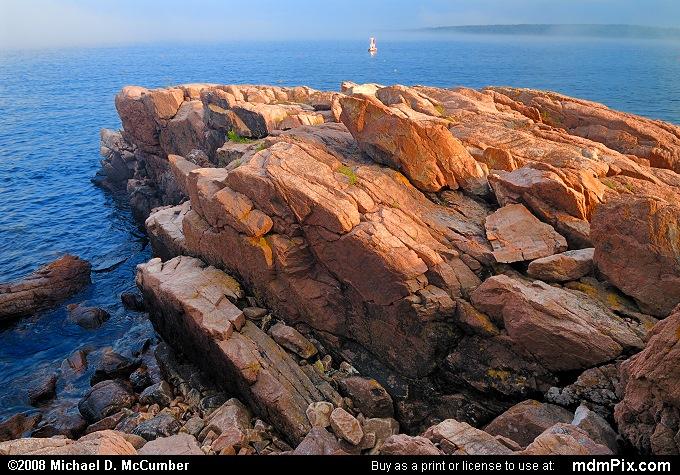 Pink Granite Rock Slab Surrounded by Atlantic Ocean