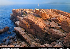Pink Granite Rock Slab Surrounded by Atlantic Ocean