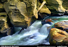 Indian Creek Cascades with Sandstone Rock Formations